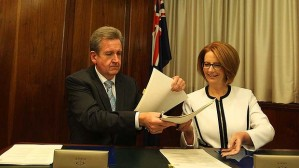 NSW Premier Barry O'Farrell signs the Gonski schools funding agreement with Julia Gillard. Image: Fairfax.